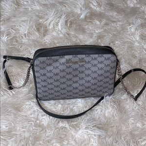 Black and grey Michael Kors crossbody purse